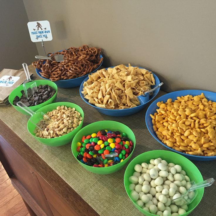Bigfoot party!  Make-your-own trail mix bar:  pretzels, Bugles, Goldfish, chocolate chunks, peanuts, M&Ms, yogurt raisins.  Cut down brown paper lunch bags with pinking shears & made custom label and sign.