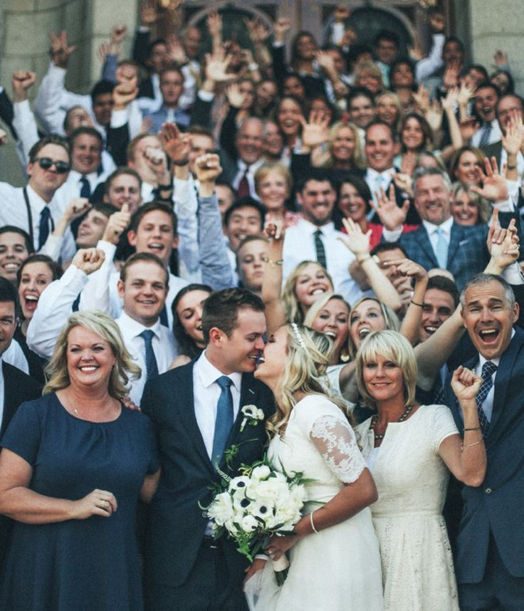 I love this unique group photo from a wedding.  So happy and fun!