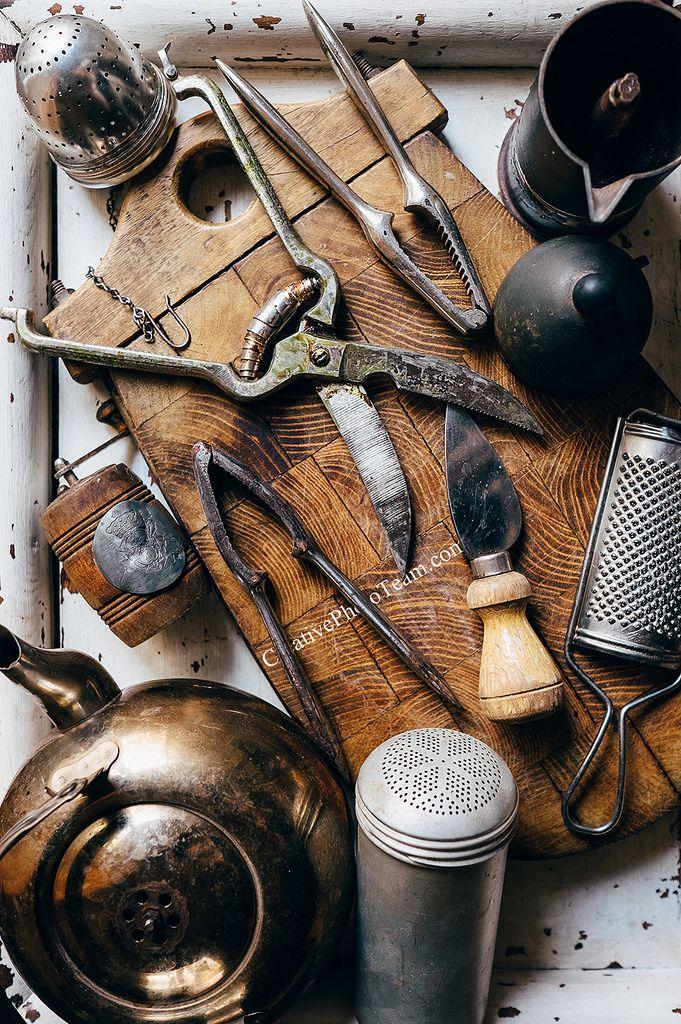 https://flic.kr/p/G4GoB7 | Old kitchen props | Old kitchen props : Nutcrackers, knives, kettle etc on the vintage cutting board. Go to your grandma countryside ...  Старая кухонная утварь : орехоколы,ножи, терки, мельницы и т.д. Давно не были у бабули в деревне?  by www.creativephototeam.com