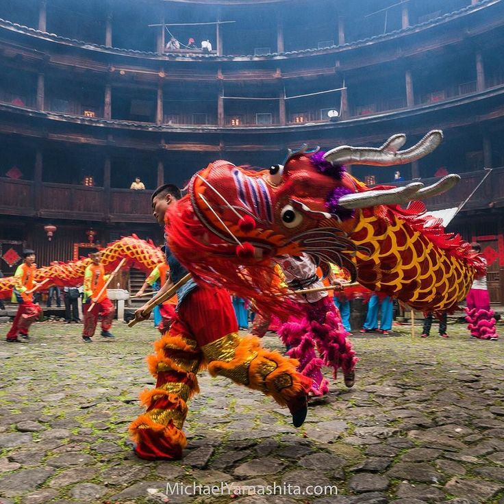 Photograph by Michael Yamashita. @yamashitaphoto - Dragon dance Tulou earth house Meilin China. Performed on festive occasions the dragon brings good luck and scares away evil spirits
