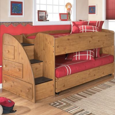 Low loft bed with bottom bed on casters - a much shorter (safer?) alternative to bunk beds.