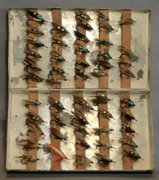 1895 Canadian, copper fly box with 51 gut eye, double hook flies-inside.