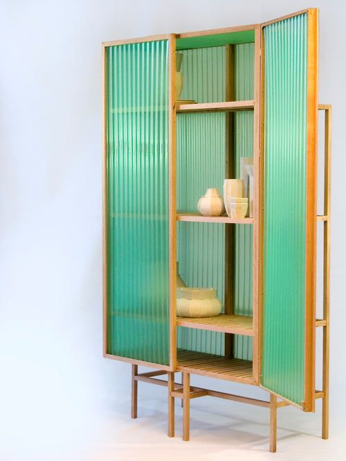 Dutch designer Dik Scheepers has created the Sine Cabinet, a cabinet made of oak, PVC, and brass that comes with a story.