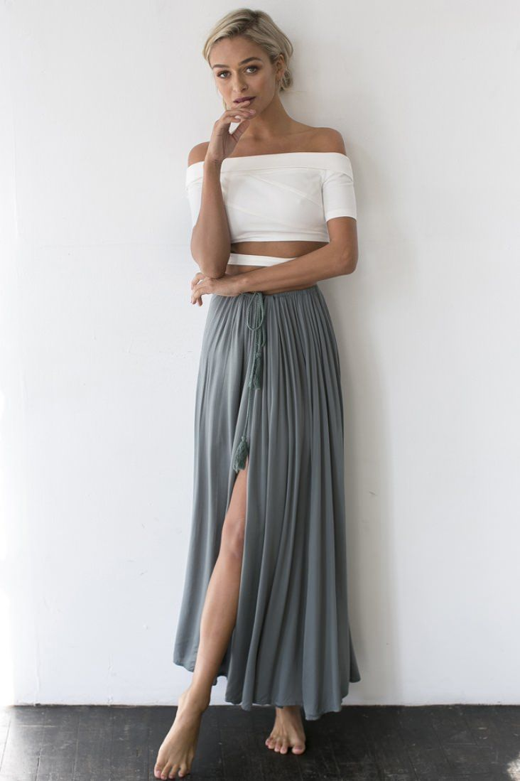 Add a little touch of boho to any outfit in the the Against The Tides Maxi Skirt! This gorgeous full length style has an elasticated waist which can be tied to worn at the waist or at the hip giving you full control of the look. The cute braided ties are decorated with soft tassel ends and there is a decorative split at the side, perfect fro showing a little leg. This gorgeous moody hue is best paired with a cute black cami and a leather jacket!  Skirt. Not lined. Cold hand wash only. Model…