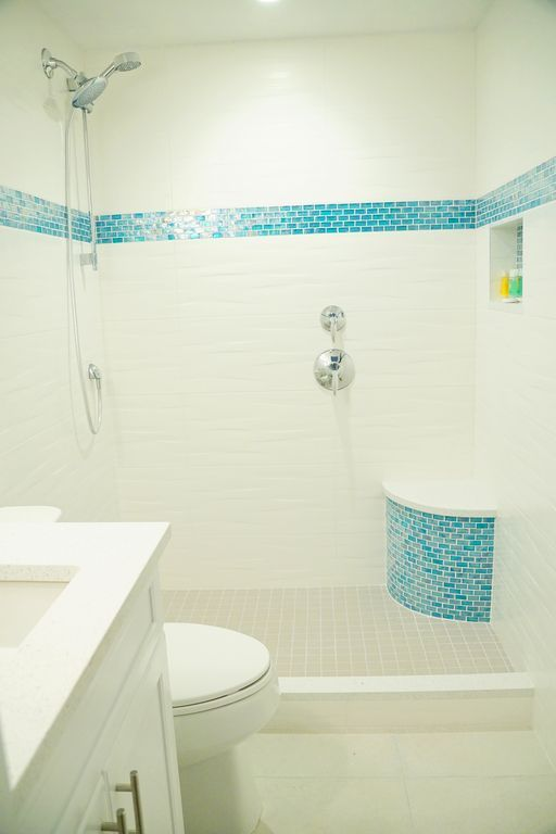 George Town condo rental - Back bath. Same double Kohler  shower heads, Quartz shower seat and . vanity top