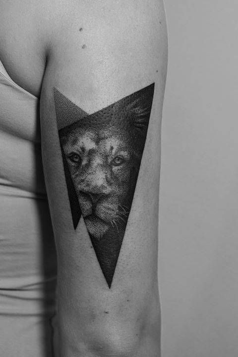 Dotwork style lion tattoo on the back of the right arm.