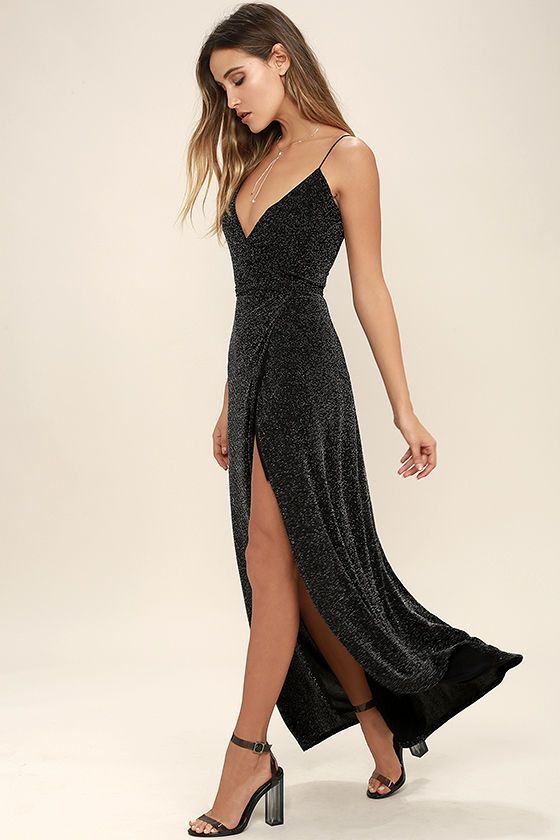 An out of this world look will be yours in the Celestial Black and Silver Wrap Maxi Dress! Sparkling silver threading dances over black knit as it shapes spaghetti straps, and wrapping triangle bodice with tying sash belt. Wrapped detail carries into a front slit maxi skirt.
