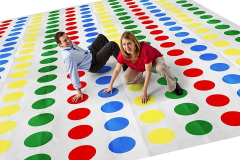 Giant game of twister...spray paint dots on giant tarps, tack tarps into lawn, let the fun ensue!