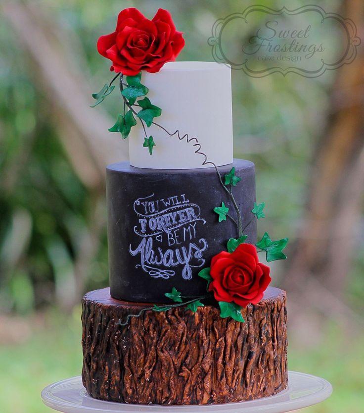 Rustic chalkboard and tree stump wedding cake with edible sugar flowers