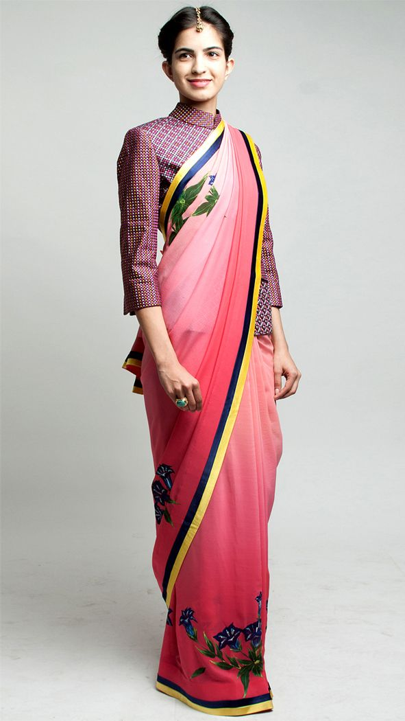 LOOK OF THE WEEK REINVENTING THE SARI Re-think traditional style by pairing a sari with a jacket rather than a blouse and staying minimalist...
