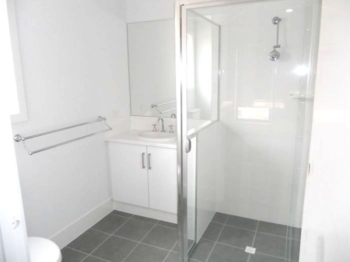 Another ensuite - note low wall between shower and vanity to protect vanity from water damage