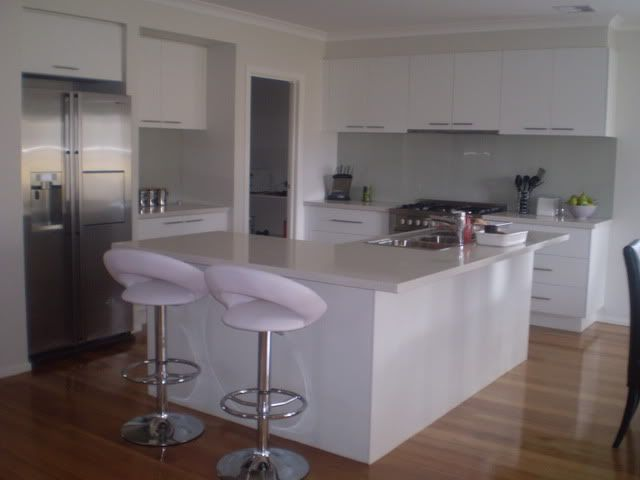 Wall colour Dulux White Duck, white cupboards and timber floors.   White Duck splash back