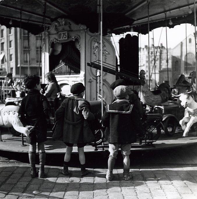 Robert Doisneau // Fairground Festivals - Les enfants du manège , Paris, 1934