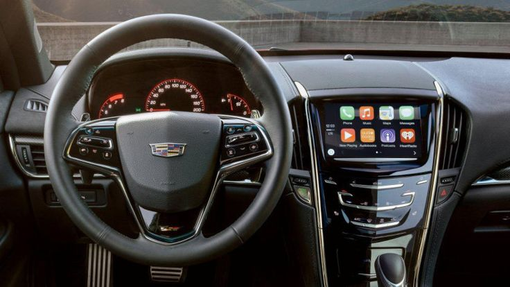 """Cadillac's CEO on Apple CarPlay: """"extremely clunky"""""""