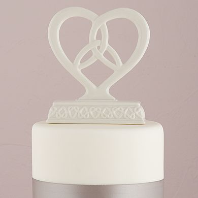 Trinity Knot Heart Framed Wedding Cake Topper.  This Glazed Porcelain Figurine has a Traditional Irish Wedding Blessing printed on the bottom surface of the base.  - May your hands be forever blessed in friendship and your hearts joined forever in Love.