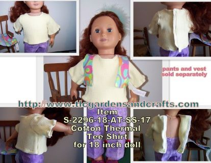 This pale yellow short sleeve t-shirt, made to fit your 18 inch Girl of Boy doll, is made with thermal knit cotton fabric, and secures the entire length of the back with white hook and loop tape for easy dressing. Stitched in matching pale yellow and white thread that hides in the thick weave of the fabric. Simple T-shirt style can be worn by girl or boy dolls alike. Shown here worn by our model, female OUR GENERATION doll, with one of our fun vests and coordinating flannel pants, this…