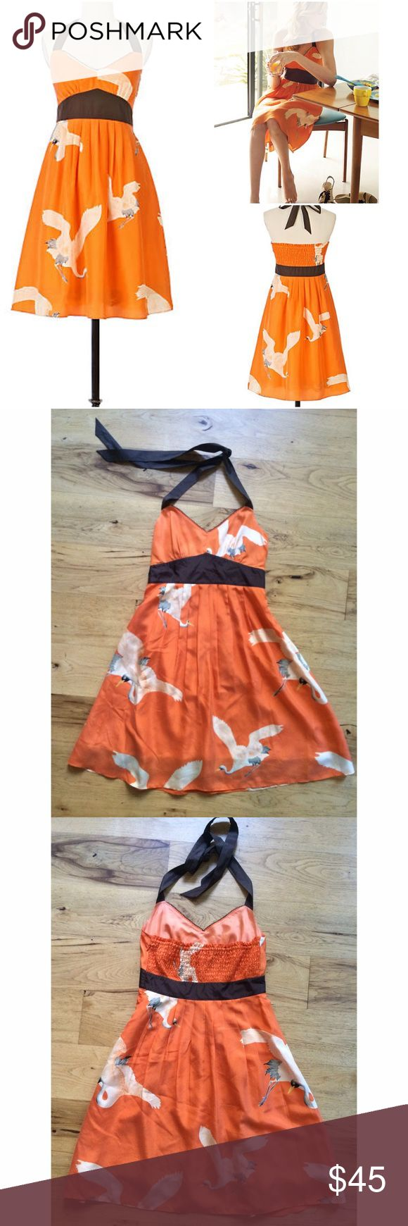 "Moulinette Soeurs Bird Crane Sandhill Halter Dress Gorgeous Anthropologie halter dress in size 6, like a medium. Long-limbed cranes soar against a feather-soft orange silk sky, as a wide waistband creates a deep chocolate horizon. Only flaw is in the back, see last pic. Not noticeable when wearing it. Can't remember how it got there. Price reflect the flaw.  Side pockets  Side zip  Silk; acetate lining  Measure about 33"" length, 14"" waist. ❌No trades or modeling. Always open to offers and…"
