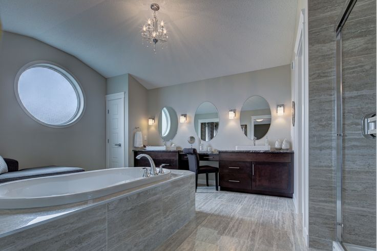 Another view of the #ensuite; we love the large make-up desk with the oval mirrors! #interiordesign