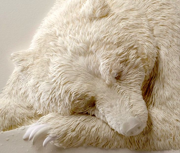 Canadian artist, Calvin Nicholls, constructs 3-D figures from paper.
