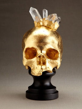 human skull replica with rock crystal