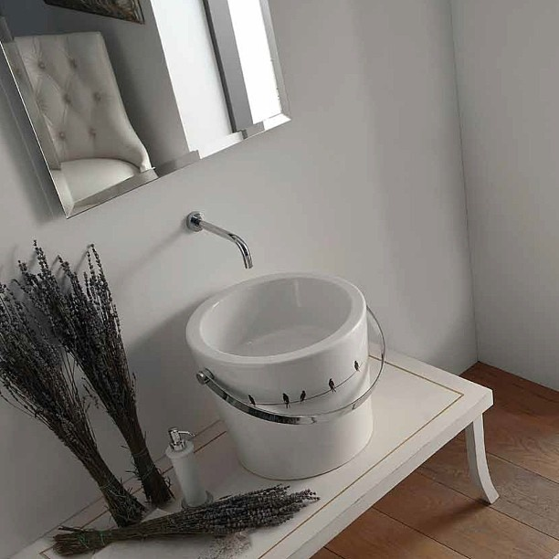 #Kypriotis #Design #Innovation #Bathroom #Tiles Washbasin looking like a bucket with birds