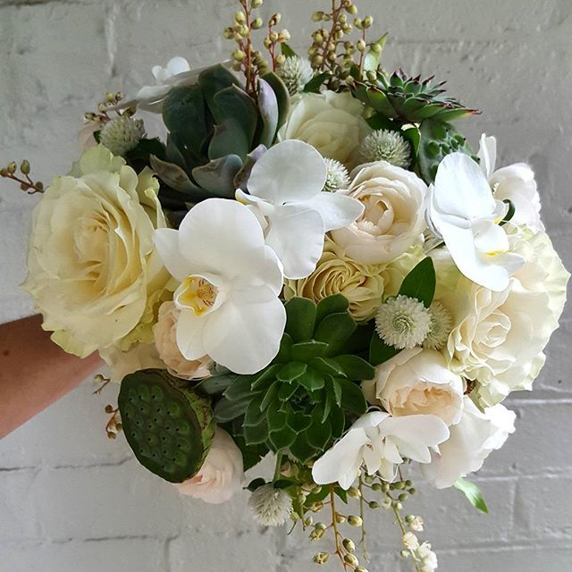 Bridal bouquet in whites, cream and greens. Lots of texture.