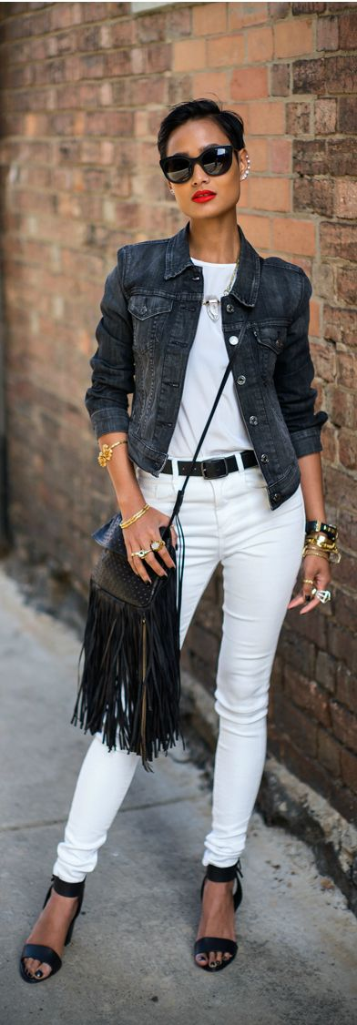 Black denim jacket, white t-shirt  & skinny jeans, black sandals & fringe shoulder bag
