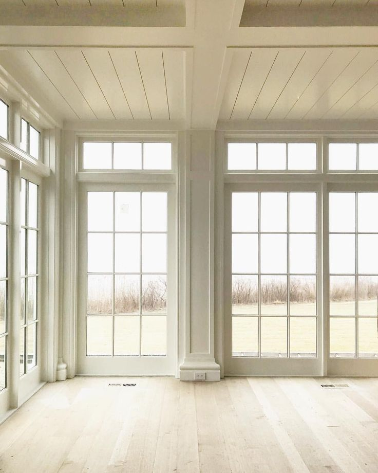 Floor to Ceiling Windows Flooding Interiors with N…