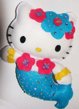 Admit it. Most people like HelloKitty. This is such a cute DIY HK mermaid doll.