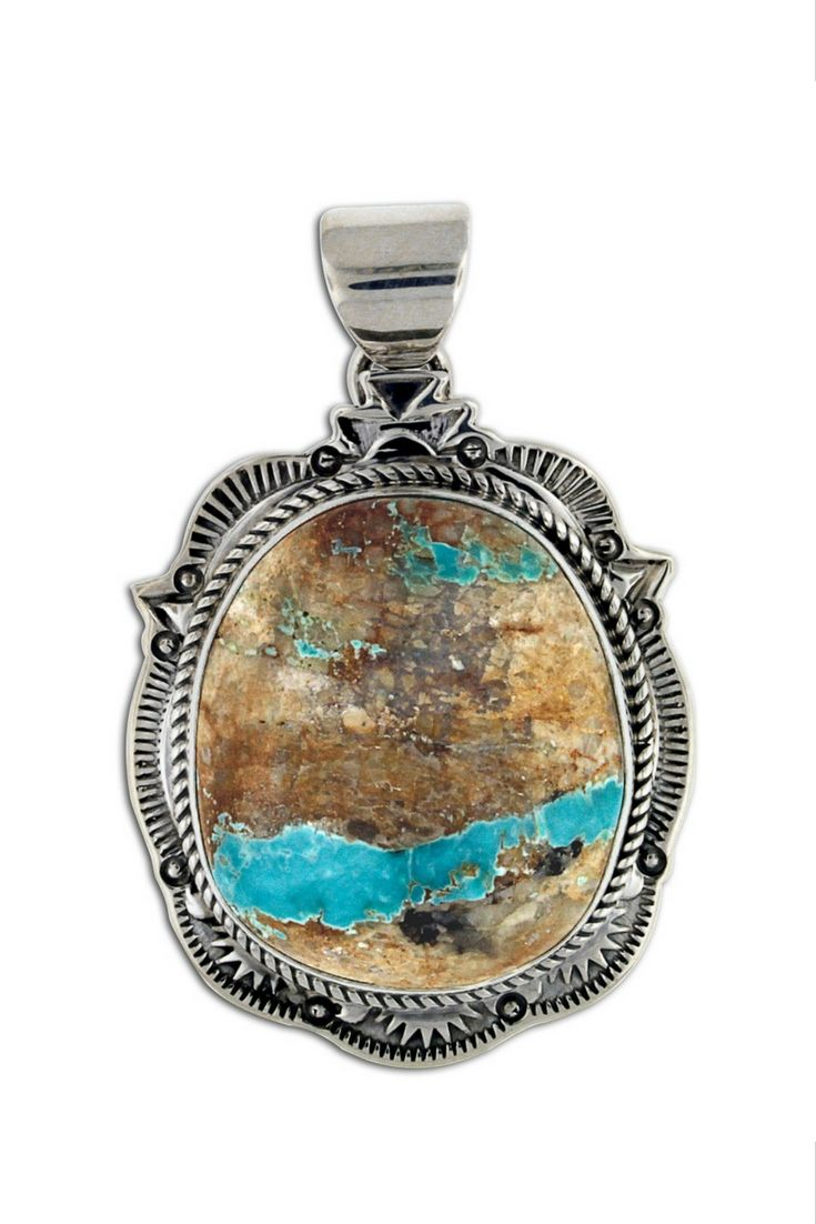 This pendant has a large Boulder Turquoise stone set in it. Boulder Turquoise typically features veins of turquoise running through the host stone which provides a bright, natural look. There is also