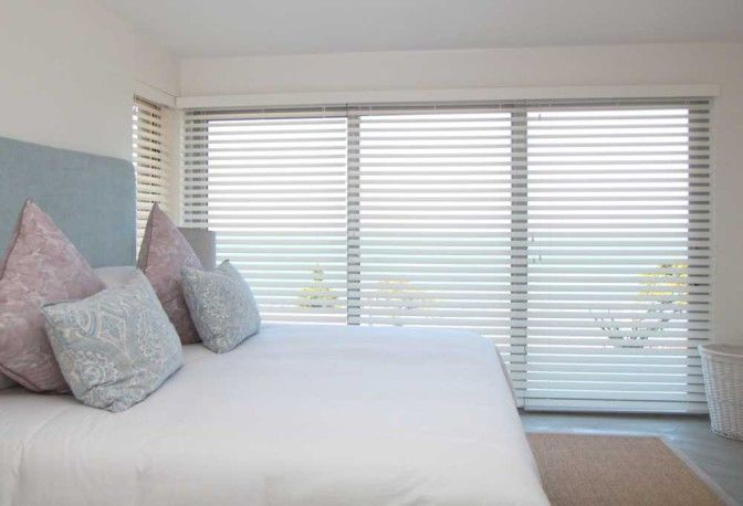 #BedroomShutters #HomeDecor #AMERICANshutters The wooden slat blinds installed in the bedroom keep the room cool during those long summer holiday days and offer the privacy that is so important in this personal space.