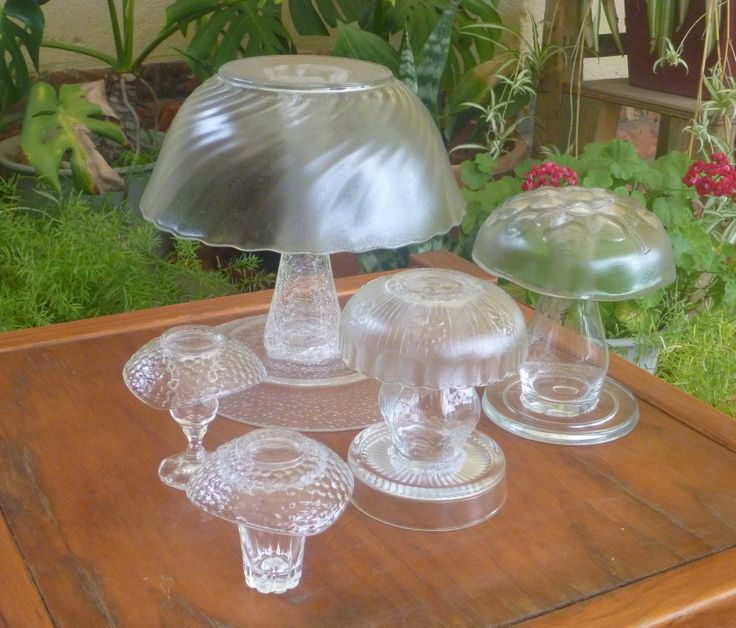 A variety of glass mushrooms, ranging from large to super-small! Any size bowl can be made into a mushroom! Just match it with a suitable 'stem'. I've used  a 'sherry' glass on the smallest mushroom & tall, glass vases for the larger mushrooms, which also have a plate glued to their base to provide stability in the garden. Soil, mulch or leaf-litter can be used to hide the 'base plate'. Tags: Glass Mushrooms, Repurpose, upcycling glass dishes, garden junk, vintage dishes, op-shop, Made By…