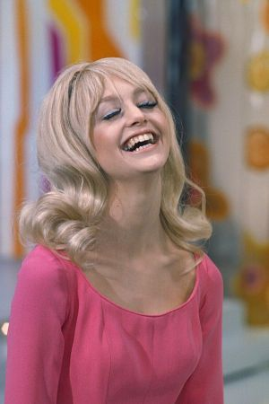 Goldie Hawn.  Her smile lights up the silver screen.