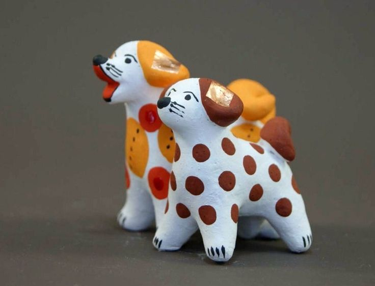 Dymkovo toy is a painted clay toy from the Russian village of Dymkovo. Two funny doggies.  #folk #art #Russian #toys