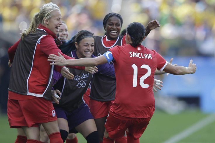 Canada's Christine Sinclair, 12, is congratulated after scoring her side's 2nd…