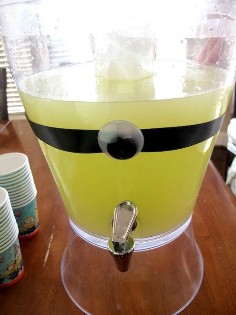Easy Minions party idea: Decorate the lemonade pitcher with ribbon or tape and one big googly eye. | My Skoop