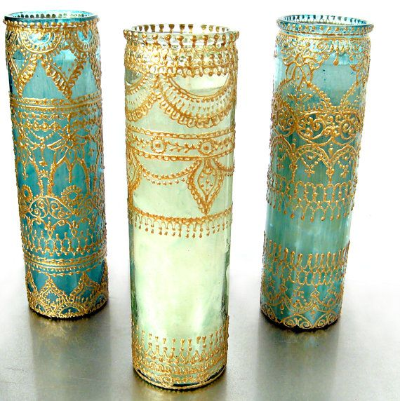 Essential Oil Scented, Eclectic Home Decor, Tall Container Candle in Hand Painted Green Glass, Aromatherapy Scented  Inspired by Moroccan decor details and henna patterns, LITdecor produces quality candles and lanterns to spice up your decor. This unique candle is hand decorated in a custom process that produces an effect similar to metal scrollwork. The glass is also hand tinted in jewel tones that are reminiscent of exotic moorish lanterns.  The glass container is the size of traditional 7…