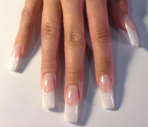 White French manicure. I've had this kind of nails before in Cali, with the long nail bed.