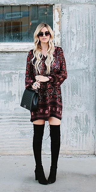 A paisley dress and over-the-knee boots
