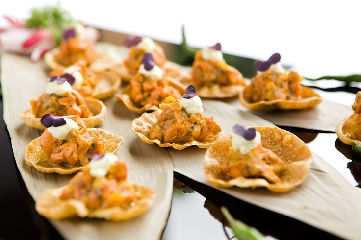 Mini poppadums with chicken tikka prepared by the chefs at The Red Olive Catering Company, UK