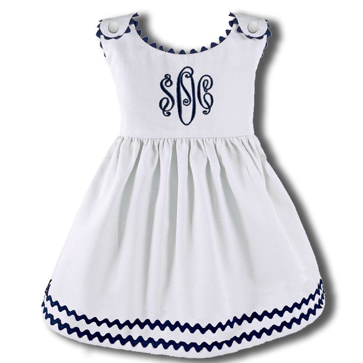 such a cute dress for a baby girl! I love the navy trim and monogram