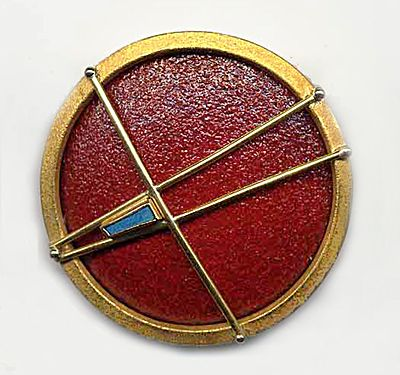 Andy Cooperman, round red enamel pin with gold wires across and opal.