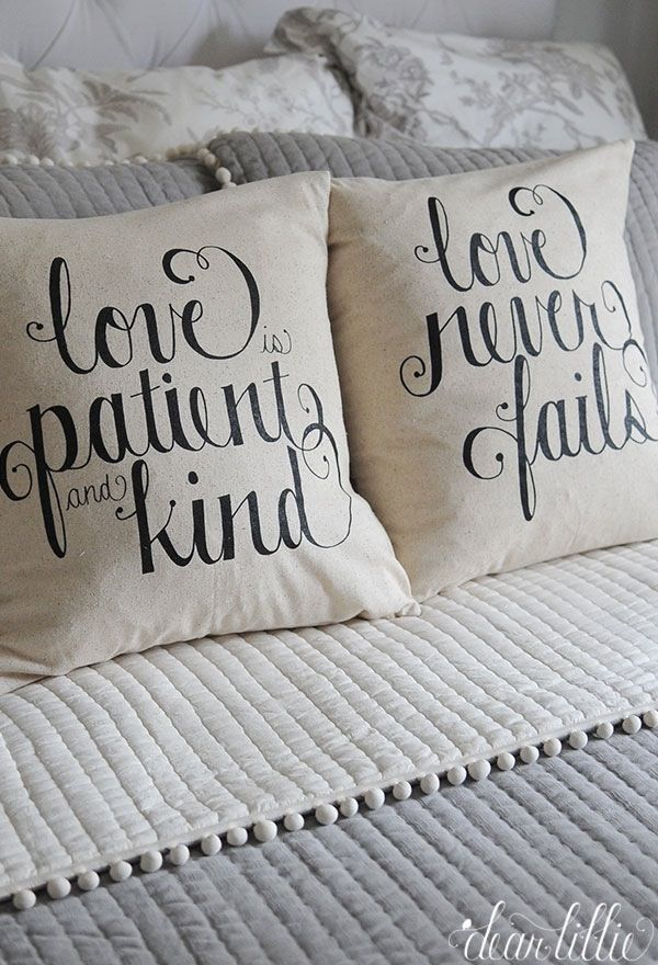 """These pillow covers are made from a 100% cotton fabric in the color """"natural linen"""". One cover has the phrase """"love is patient and..."""