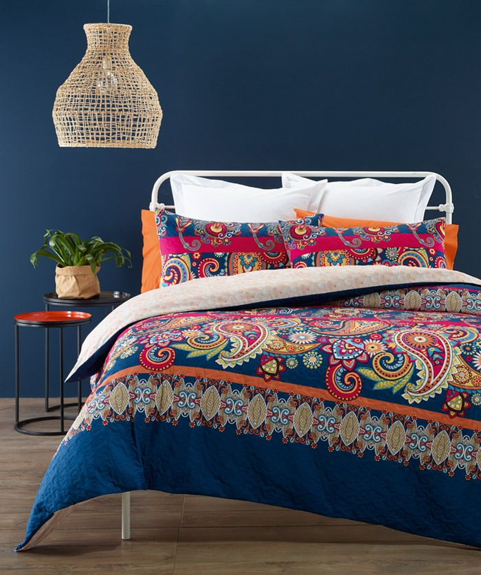 Luxurious soft touch quilted look fabric. Bold floral print in front with earthly tones on the back. Blend of Blue, Burnt Orange, Pink, Black, White and Yellow