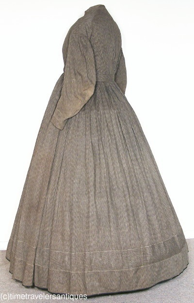 """Printed cotton day dress, lined, fan-pleated bodice with front hook & eye closure, piping at collar and armscyes; unlined skirt with hook & eye waist closure; bias cut bands at cuffs of coat sleeves, calico hem facing, black twill tape at hem; bust: 36""""; waist: 31""""; 55"""" shoulder to hem.  Some perspiration to lining, some pin dots, mend above back hem, scattered brown spots; Time Travelers Antiques & Vintage clothing; ebay"""
