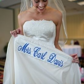 This bride surprised her husband with her married name sewn underneath her dress as her something blue. Cute!