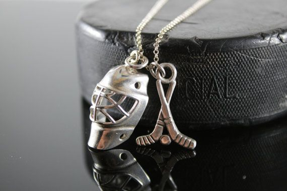 Check out this item in my Etsy shop https://www.etsy.com/ca/listing/265858565/sterling-silver-goalie-hockey-helmet-and