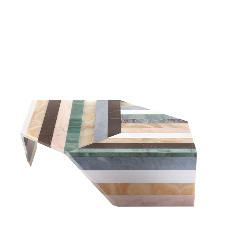Marble is used like paper to create Origami tables inspired by the Japanese art of origami: the strips of polychrome marbles used for the top are bent 90