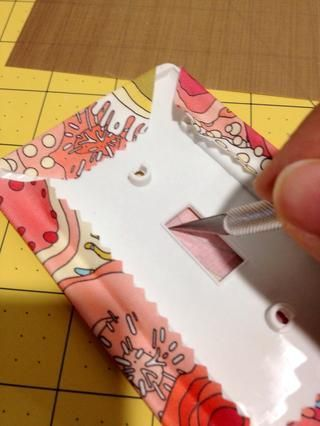 When dry, cut an X in the switch window of plate and fold in the fabric/paper edges, or cut out the window rectangle.