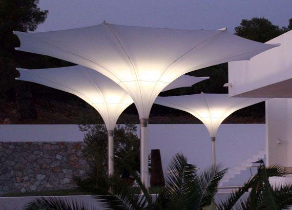 Soft light of garden parasol at night